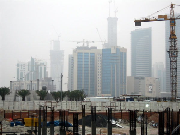 Construction site and modern buildings