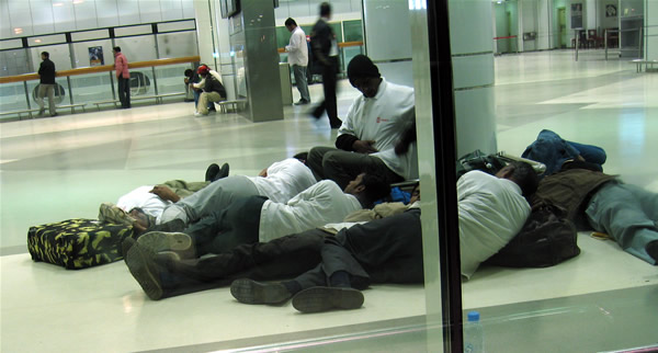 Foreign workers, Doha International Airport, 1.30 am.