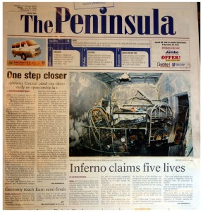 Photograph of part of the front page of The Peninsula newspaper, showing a photograph of a burned out room. The article below is headed <em>Inferno Claims Five Lives.</em>