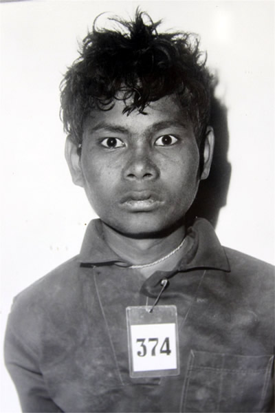 A prisoner, photographed on arrival at the Tuol Sleng Prison.